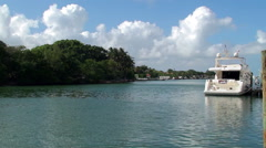 Pleasure yacht in Indian Creek bay at the Mid-Beach of Miami Beach Stock Footage