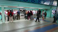 KTM Komuter ticket machines, people queue, service works - stock footage