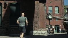 Man jogs in old part of town Stock Footage