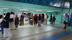 Ticket machine technical maintenance on LRT station people queue to working Stock Footage