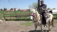 Man rides horse on riding course lessons. 4k uhd steadycam stock footage Stock Footage