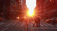 Manhattanhenge urban city sunset crowd walking street Stock Footage