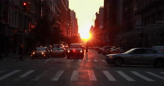 Manhattanhenge urban city sunset crowd walking street Stock Footage