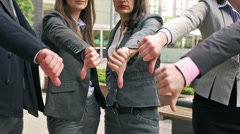 Businesspeople showing fingers down to the camera Stock Footage