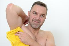 Happy Middle Age Man Drying his armpit with Towel Stock Photos