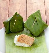 Stock Photo of Thai Dessert - Sticky Rice with Custard on white dish