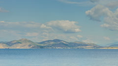 Large Clouds Over The Sea And The Island Stock Footage