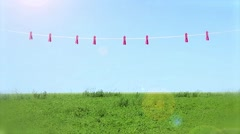 Beautiful Young Woman Hangs Laundry On A Background Summer Landscape Stock Footage