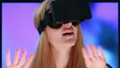 Virtual reality game. Girl with pleasure uses head-mounted display. Stock Footage