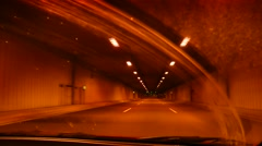 Driving a car in a tunnel. - stock footage