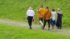 People in medieval costume - walk in slow motion Stock Footage