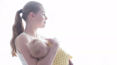 Mother keeping her baby on hands - stock footage