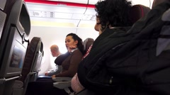 Smiling. Happy. friends travelling by plane together talking and chating. Tou Stock Footage