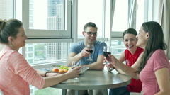 Friends sitting together in the apartment and drinking wine - stock footage