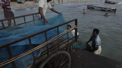Indian fishers on the sea coast, India Stock Footage