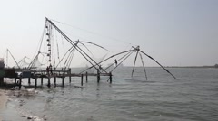 Indian fishers on the sea coast, Fort Kochi, India Stock Footage