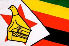 Detail on the flag of Zimbabwe - stock photo
