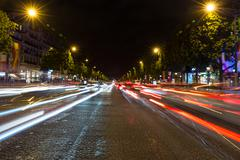 Stock Photo of Evening streetview with illumination and traffic of Paris Champs Elysees
