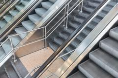 Escalators and stairs in a shopping mall Stock Photos
