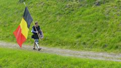 Medieval knight from Belgium walk with flag. Slow motion Stock Footage