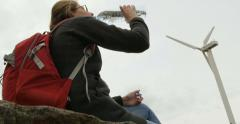 Beautiful female hiker drinking purified water Stock Footage