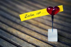 """handwritten german quote """"Liebe ist..."""" (love is...) - stock photo"""