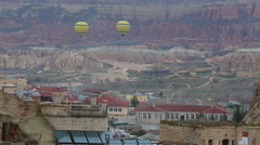 Colorful hot air balloons flying over valleys in Goreme, Turkey Stock Footage