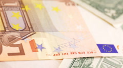 Euro and Dollar banknotes on rotating display - closeup Stock Footage