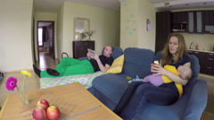 Happy family spend time together on sofa. 4K Stock Footage