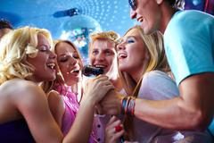 Singing friends - stock photo