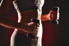 Exercising with dumbells - stock photo