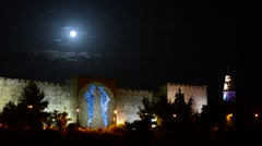 Lightshow and full moon at the walls of Jerusalem - stock footage