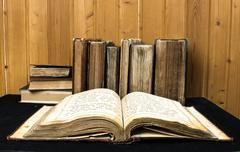 old books on a wooden, vintage style - stock photo