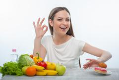 Pretty young girl is refusing to eat unhealthy food - stock photo
