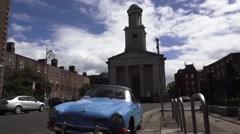 Dublin church with blue classic car Stock Footage