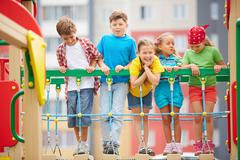 Kids on playground - stock photo