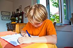 boy doing his homework for school - stock photo