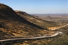 Remote desert road - Damaraland - Namibia Stock Photos