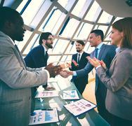 Congratulating colleagues Stock Photos