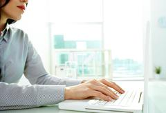 Typing at office Stock Photos