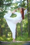 Flexible woman - stock photo