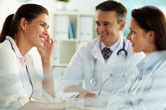 Physicians and patient - stock photo