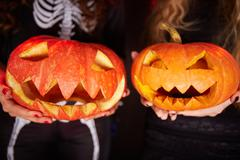 Pumpkin grins Stock Photos