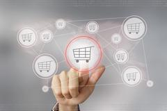 Business hand pushing e-commerce button Stock Photos