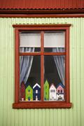 Icelandic cottage with Troll Houses in the window - Iceland - stock photo