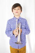 boy with trumpet - stock photo