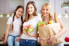 Family with foodstuff Stock Photos