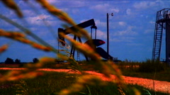 Oil Well and grain leaf - stock footage