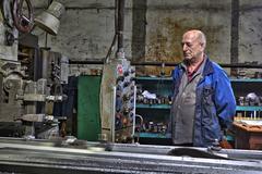 Machine tool operator, planer boring milling controls  processing of metal. - stock photo