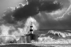 Waves crashing over Seaham Lighthouse - stock photo